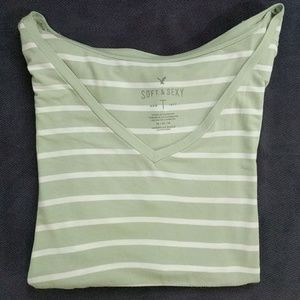 A green and white stiped V neck t-shirt